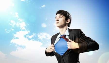 open shirt: Image of young businessman showing superhero suit underneath his shirt