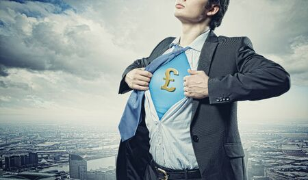 Image of young businessman in superhero suit with pound sign on chest Stock Photo - 17760484