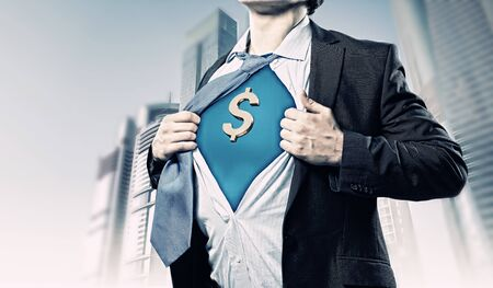 Image of young businessman in superhero suit with dollar sign on chest Stock Photo - 17760461