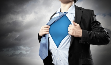 courageous: Image of young businessman showing superhero suit underneath his shirt