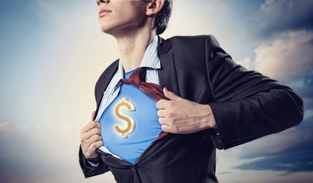 moneymaking: Image of young businessman in superhero suit with dollar sign on chest