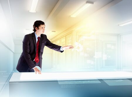 young businessman touching icon of high-tech image Stock Photo
