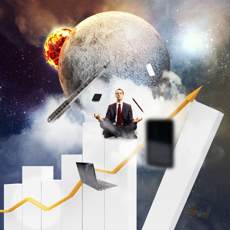aloft: Businessman sitting on bars in lotus flower position against space background with office stuff aloft Stock Photo