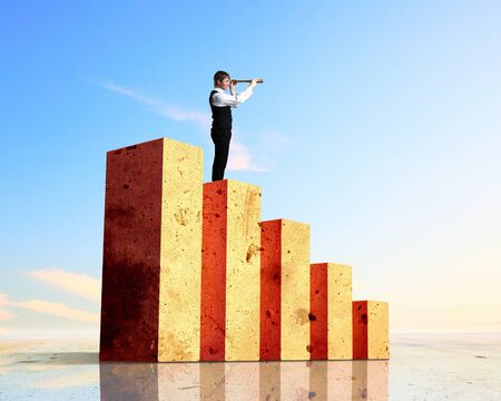 Business person on a graph, representing success and growth Stock Photo - 17769761