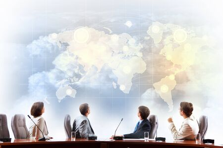 worldwide: Image of businesspeople at presentation looking at virtual project