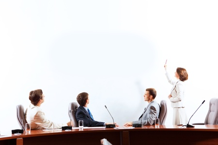 advertisment: Image of businesspeople at presentation looking at screen  Space for advertisment