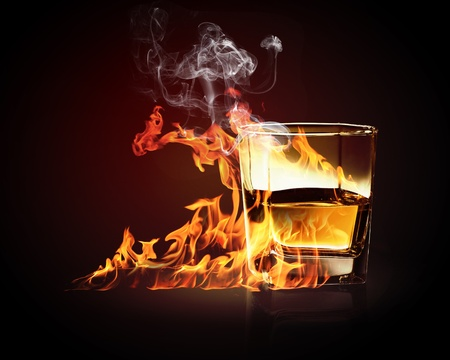 Image of glass of burning yellow absinthe Stock Photo - 17821345