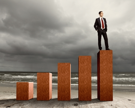 Business person on a graph, representing success and growth Stock Photo - 17827713