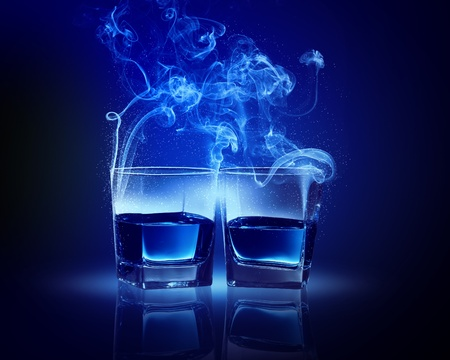 fume: Two glasses oа blue cocktail with fume going out Stock Photo