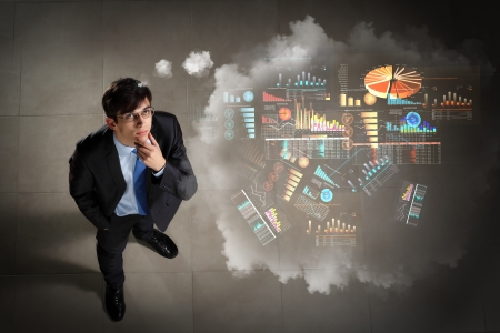 solving problem: Top view of young businessman making decision diagram in air
