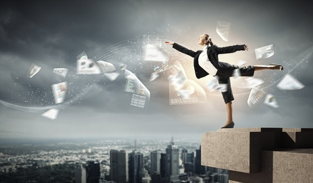precipitate: Image of pretty businesswoman balancing on the roof above cityscape Stock Photo