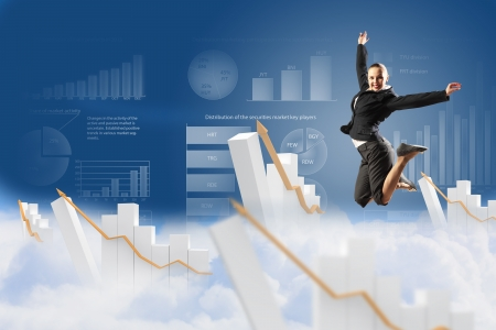 pretty businesswoman jumping high against diagram background photo