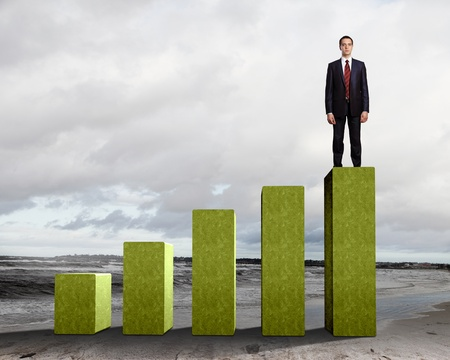Business person on a graph, representing success and growth Stock Photo - 17869548