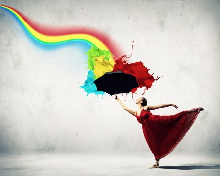rainbow umbrella: ballet dancer in flying satin dress with umbrella and a rainbow