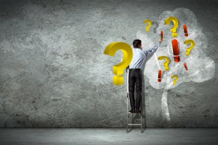 Image of businessman standing on ladder against question signs Stock Photo - 18021185