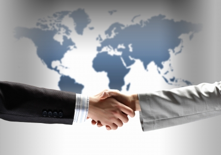 business handshake against white background with map image photo