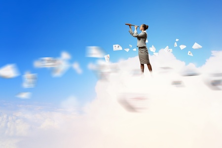 Image of businesswoman looking in telescope standing atop of cloud Stock Photo - 18020689