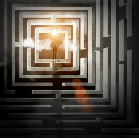 Silhouette of businessman standing in maze sun above photo