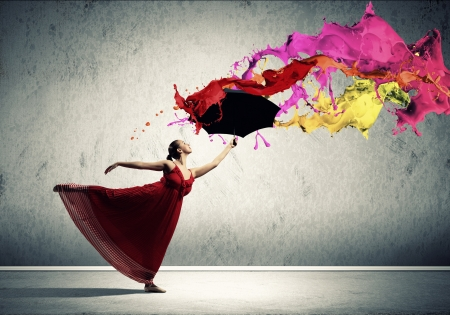 ballet dancer in flying satin dress with umbrella under the paint photo