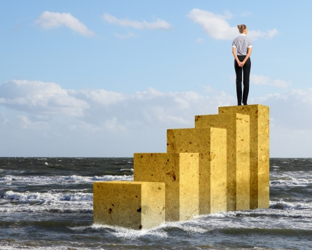 Business person on a graph, representing success and growth photo