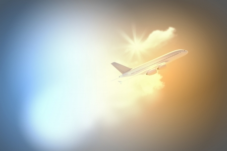 Image of flying airplane in clear sky with sun at background photo