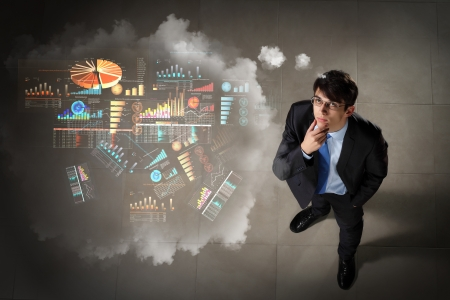 doubt: Top view of young businessman making decision diagram in air