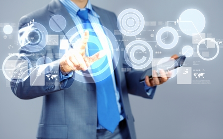 image of businessman touching screen with finger holding pad photo