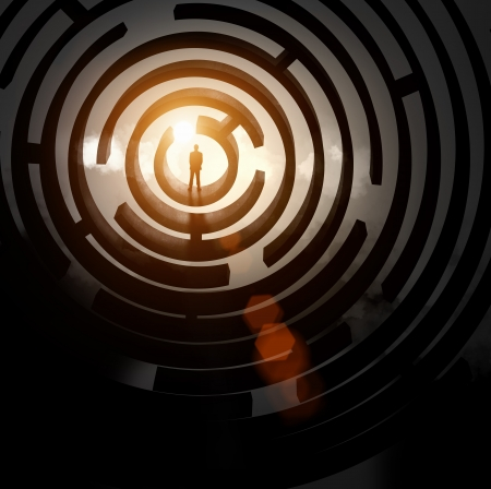 wayout: Silhouette of businessman standing in maze sun above