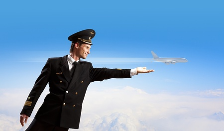 Image of pilot touching sky against airplane background photo
