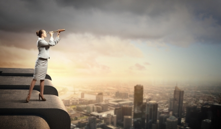 entrepreneur: Image of businesswoman looking in telescope standing a top of building