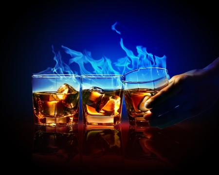 objects drink: Image of three glasses of burning yellow absinthe