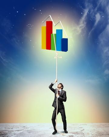 aloft: Image of businessman climbing rope attached to diagram aloft