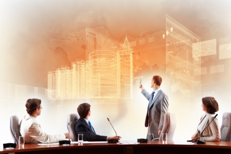 presentation board: Image of businesspeople at presentation looking at virtual project