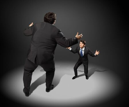 contender: Image of businesspeople arguing and acting as sumo fighters Stock Photo