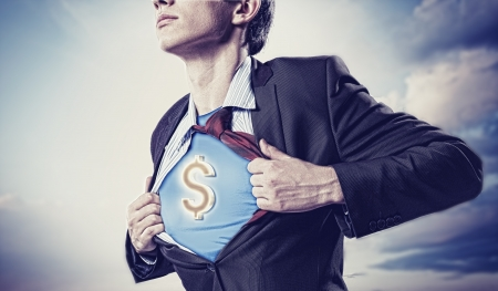 Image of young businessman in superhero suit with dollar sign on chest Stock Photo - 18394196