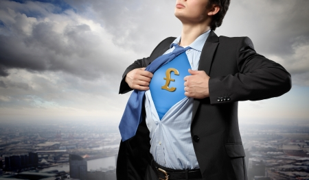 moneymaking: Image of young businessman in superhero suit with pound sign on chest