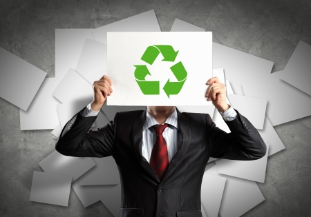 eco sensitive: Image of man holding board with recycling sign