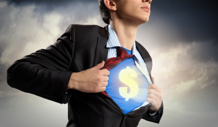 Image of young businessman in superhero suit with dollar sign on chest Stock Photo - 18394183