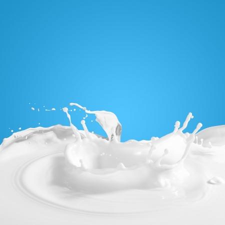 milk: Pouring white milk splash on colour background