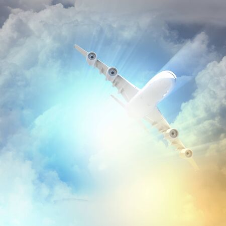 Image of flying airplane in sky with clouds at background photo