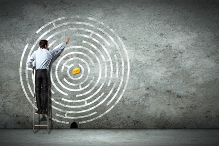seeking assistance: Image of businessman standing on ladder against maze picture Stock Photo