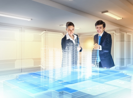 clicking: young businesspeople clicking on icon of high-tech image Stock Photo