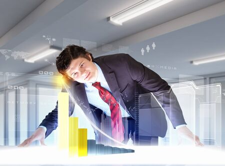 Image of young businessman looking at high-tech picture Stock Photo - 18391814