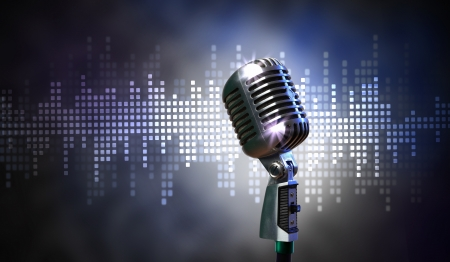 Single retro microphone against colourful background with lights Stock Photo - 18395030