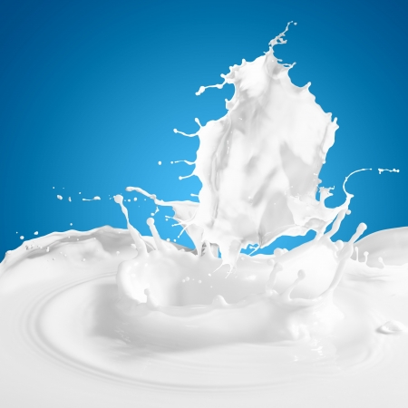 Pouring white milk splash on colour background photo