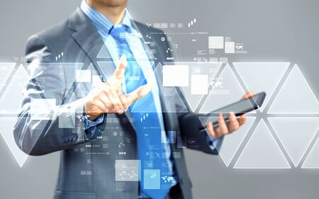 access point: image of businessman touching screen with finger holding pad Stock Photo