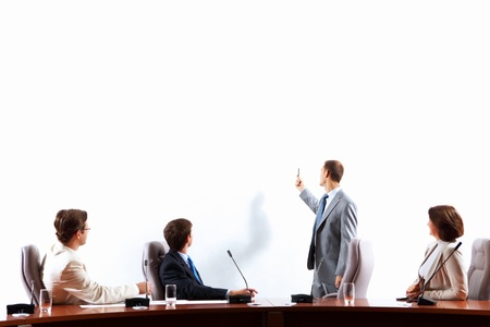 presentation board: Image of businesspeople at presentation looking at screen  Space for advertisment