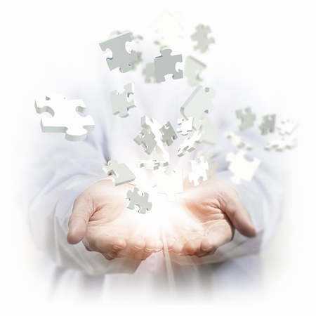 team success: White multiple puzzle piece flying in different directions