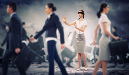 problemsolving: Image of businesswoman in blindfold walking among group of people