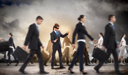 sightless: Image of businessman in blindfold walking among group of people Stock Photo